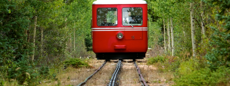 The front of a red train on tracks