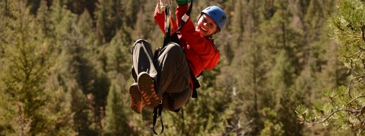A woman ziplining at Soaring Adventures