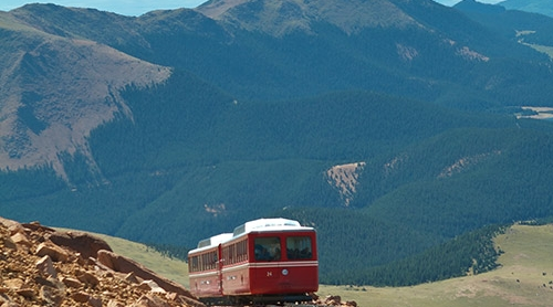 The Cog Railway train coming around a corner on Pikes Peak Mountain